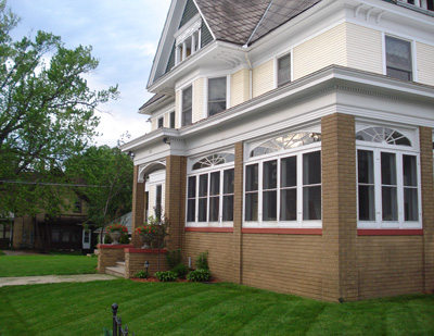 Wrap around Porch Enclosed and Columns replaced by Brick
