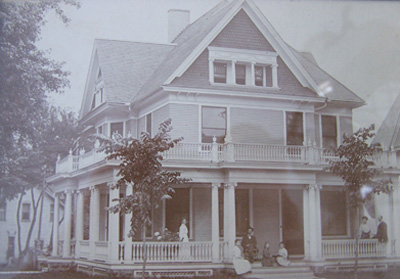 The Victorian house with original double and triple columns and railings before the porch transformation