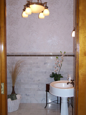 Marble tile and pedestal sink